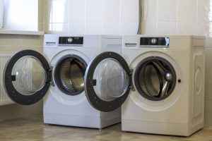 depositphotos 179249222 stock photo two open washing machines in