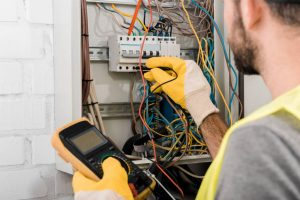 depositphotos 217089698 stock photo cropped image electrician checking electrical