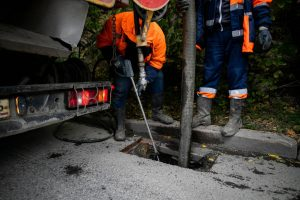 depositphotos 411564768 stock photo cleaning storm drains debris clogged
