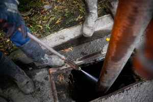depositphotos 411564786 stock photo cleaning storm drains debris clogged