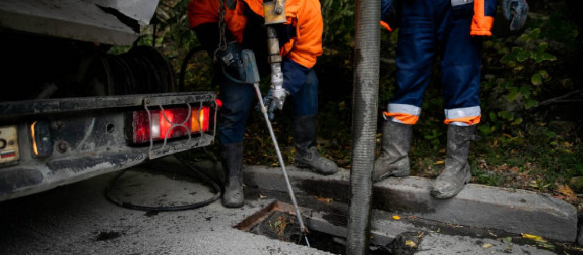 depositphotos_411564768-stock-photo-cleaning-storm-drains-debris-clogged